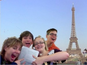 4 grinning students, 1 assignment, and the Eiffel Tower