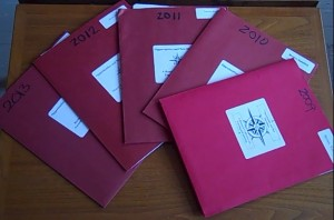 Image of five program folders from past OND Conferences