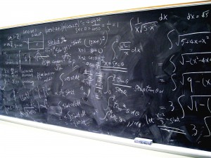 Blackboard with algebra problems written on it.