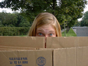 girl looking over a box