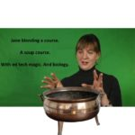 Jane Holbrook gestures over a copper pot.