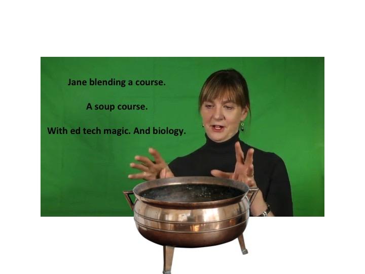 Jane Holbrook gestures over a copper pot.